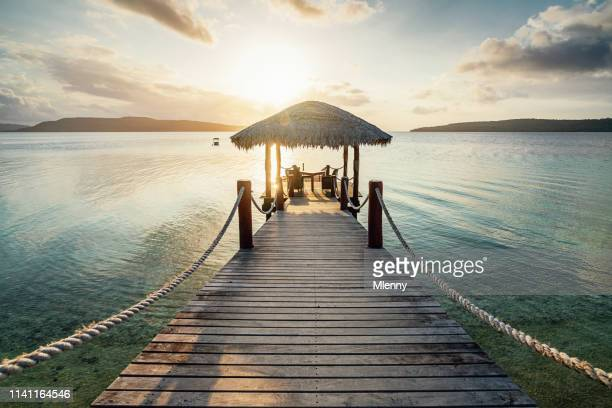 vanuatu romantic sunset jetty efate island - jetty stock pictures, royalty-free photos & images
