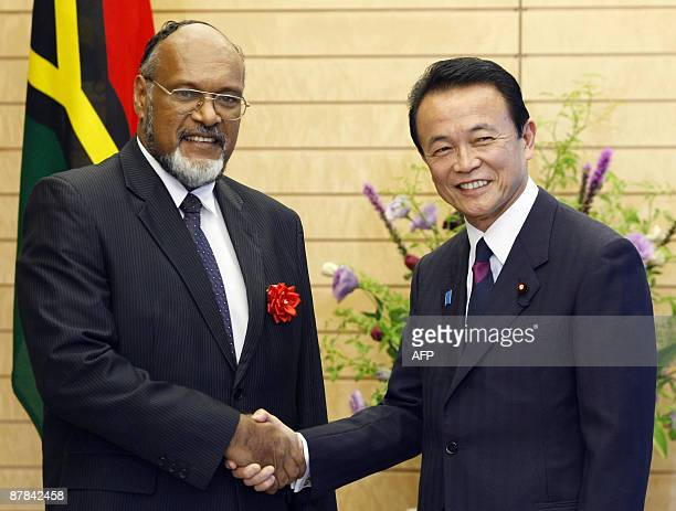 Vanuatu's Prime Minister Edward Natapei and Japan's Prime Minister Taro Aso shake hands prior to their talks at the latter's official residence in...