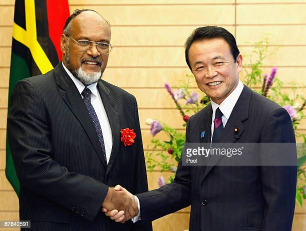Vanuatu's Prime Minister Edward Natapei and Japan's Prime Minister Taro Aso shake hands prior to their talks at Aso's official residence on May 19...