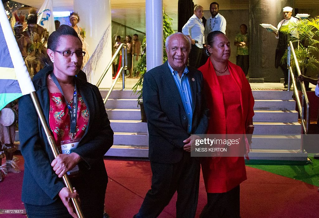 Vanuatu's Prime Minister Sato Kilman (C) arrives for the official opening of the 46th Pacific Islands Forum (PIF) in Port Moresby on September 8, 2015. The 16-nation grouping consists mainly of small island nations, together with Australia and New Zealand, with the two developed nations being accused of dragging their feet on climate change. AFP PHOTO/Ness KERTON