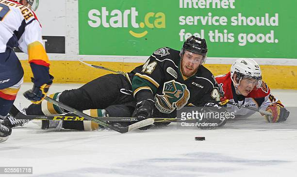 Vanya Lodnia of the Erie Otters battles for the puck against Jacob Graves of the London Knights during game four of the OHL Western Conference Final...
