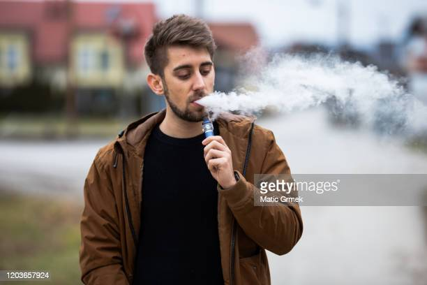 vaping man - hitech mod a stock pictures, royalty-free photos & images