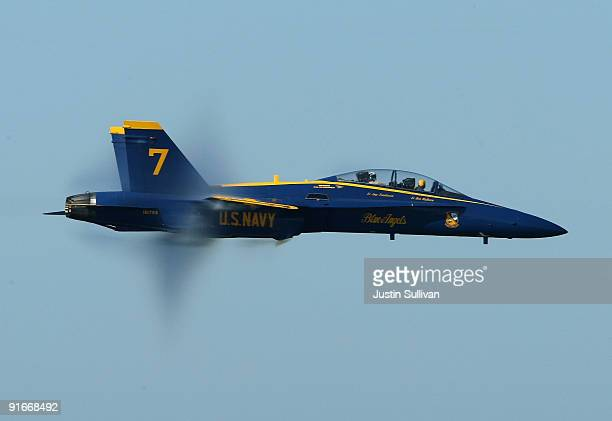 Vapor comes off the wings of a US Navy Blue Angels F/A18 Hornet during a practice performance ahead of the Fleet Week air show October 9 2009 in San...