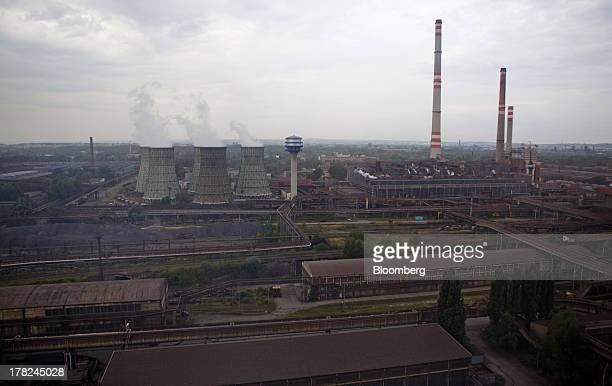 Vapor rises from cooling towers at ArcelorMittal's steel plant in Ostrava, Czech Republic, on Monday, Aug. 26, 2013. ArcelorMittal, the world's...