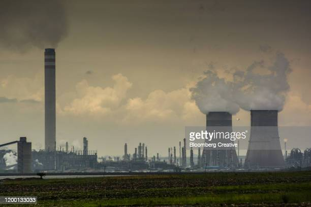 vapor rises from cooling towers - mpumalanga province stock pictures, royalty-free photos & images