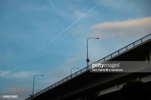 Vapor trail in the blue sky on Singapore
