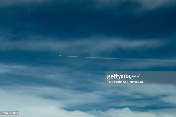 A vapor trail in the blue sky