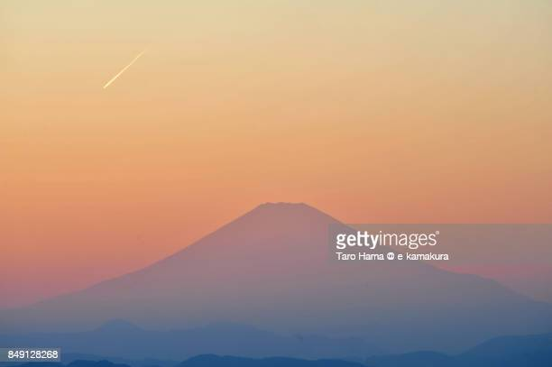 Vapor trail on Mt. Fuji in the sunset