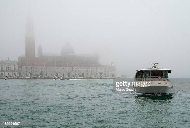 Vaporetto approaches the waterbus stop at Saint Mark's on October 27, 2013 in Venice, Italy. Venice woke up this morning under the first blanket of...