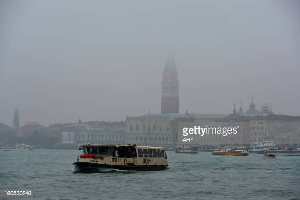 Vaporetto passes in front of St Mark's square during the carnival on February 2, 2013 in Venice. The 2013 edition of the Venice carnival is untitled...