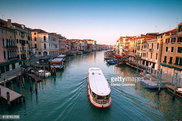 vaporetto passing on grand canal, venice, italy - vaporetto stock-fotos und bilder