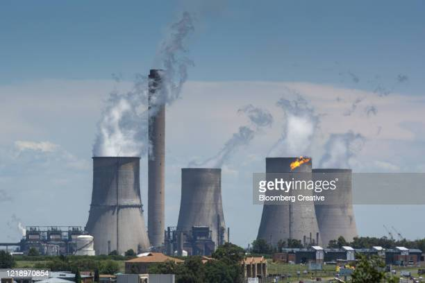 vapour rises from cooling towers - mpumalanga province stock pictures, royalty-free photos & images