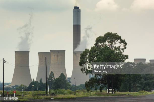 Vapour rises from the cooling towers of the Komati coal-fired power station, operated by Eskom Holdings SOC Ltd., in Mpumalanga, South Africa, on...