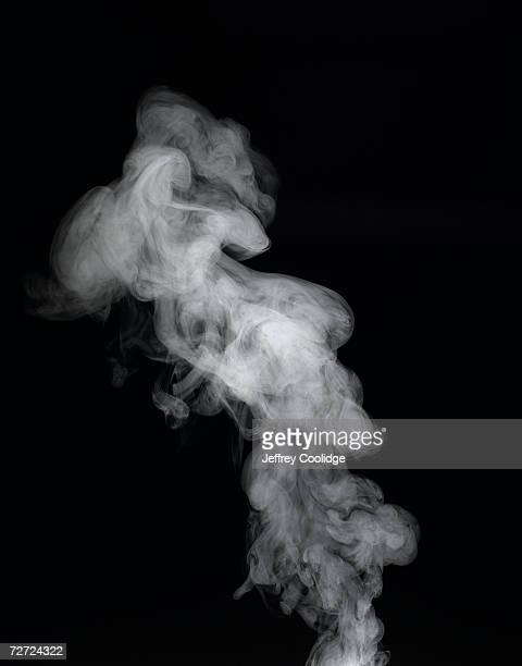 vapour rising against dark background - fumo materia foto e immagini stock