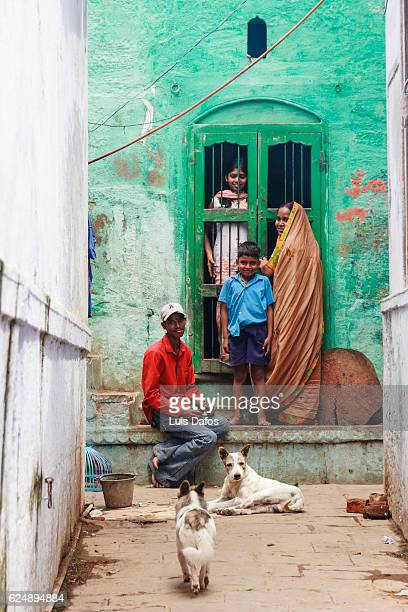 varanasi, colourful alley with people - dafos stock photos and pictures
