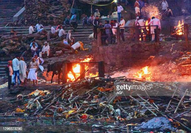 Varanasi . Uttar Pradesh. India. Two ghats are dedicated to the traditional cremations. According to Hinduism a dead human's soul finds salvation ....
