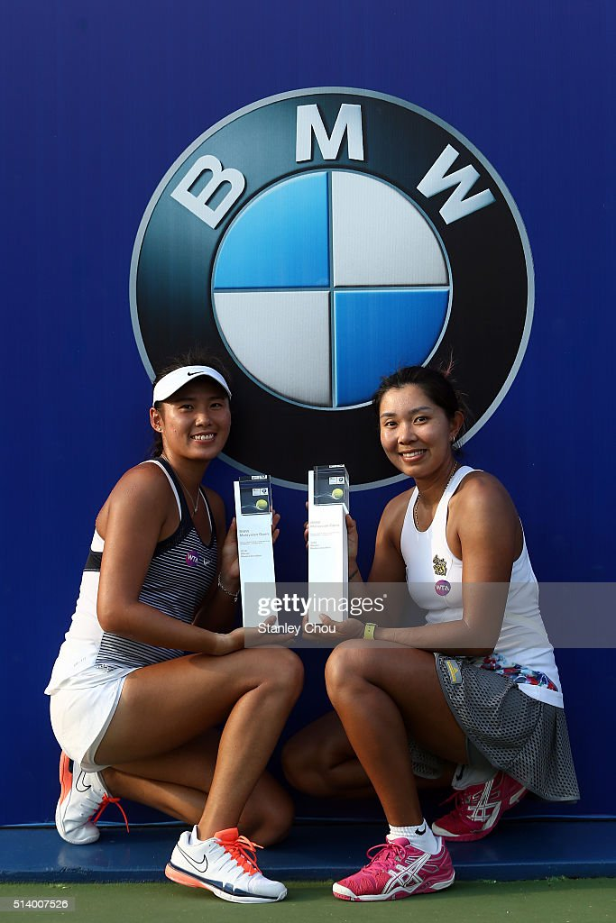 Varatchata Wongteanchai (R) of Thailand and Zhaoxuan Yang of China pose with the BMW Malaysian Open Doubles Champion Trophy after the Doubles Final of the 2016 BMW Malaysian Open at Kuala Lumpur Golf & Country Club on March 5, 2016 in Kuala Lumpur, Malaysia.