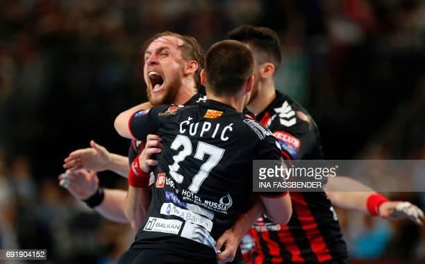 Vardar's Luka Cindric and Ivan Cupic celebrate the 2625 during Handball EHF Champions League Final Four semi final match between HC Vardar and FC...