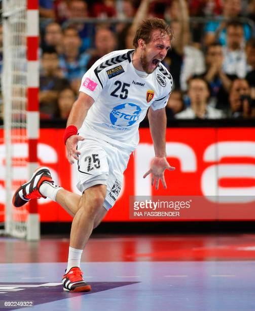 Vardar's Luka Cindric celebrates a goal during the Handball EHF Champions League final Four final match between Paris SainttGermain and HC Vardar in...