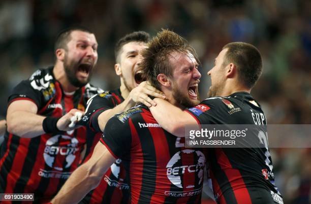 Vardar's Stojanche Soilov Alex Dujshebaev Dovichevaeva Luka Cindric and Ivan Cupic celebrate the 2625 victory against Barcelona during Handball EHF...
