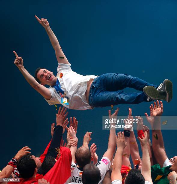 Vardar's team celebrates their coach Raul Gonzalez Gutierrez during the victory ceremony after the Handball EHF Champions League final Four final...
