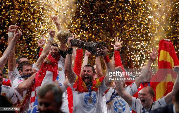 Vardar's team celebrates with the trophy during the victory ceremony after the Handball EHF Champions League final Four final match between Paris...