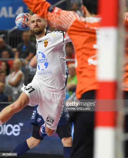 Vardar's Timur Dibirov shoots during the third place handball match HC Vardar against Paris SaintGermain Handball at the EHF Pokal men's Champions...
