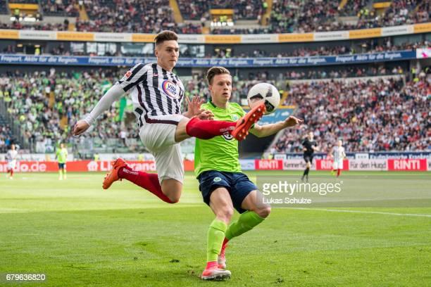 Varela Guillermo of Frankfurt and Yannick Gerhardt of Wolfsburg fight for the ball during the Bundesliga match between Eintracht Frankfurt and VfL...