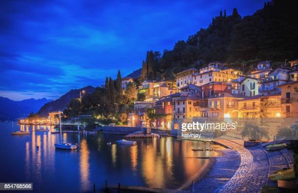 Varenna on the shore of Lake Como, Italy, showing houses, bars and restaurants in the evening.