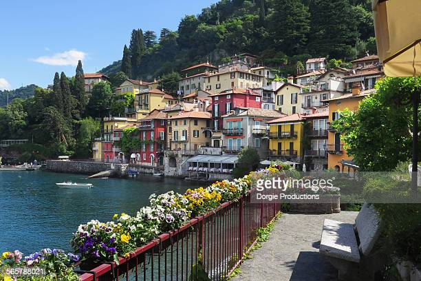 varenna with flowers in foreground on lake como - como italy stock pictures, royalty-free photos & images