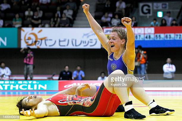 Vareria Zholobova of Russia celebrates winning the 55kg division of the final match against Saori Yoshida of Japan during day two of the 2012 Female...