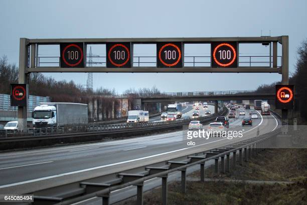 variable message signs highway car truck - speed limit sign stock photos and pictures