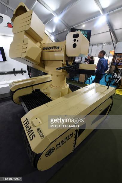 A variant of the Tracked Hybrid Modular Infantry System unmanned ground vehicle by MBDA and Milrem Robotics is displayed during the Special...