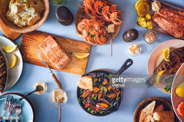 variation of grilled prawns and salmon with fresh lemon - seafood stock pictures, royalty-free photos & images