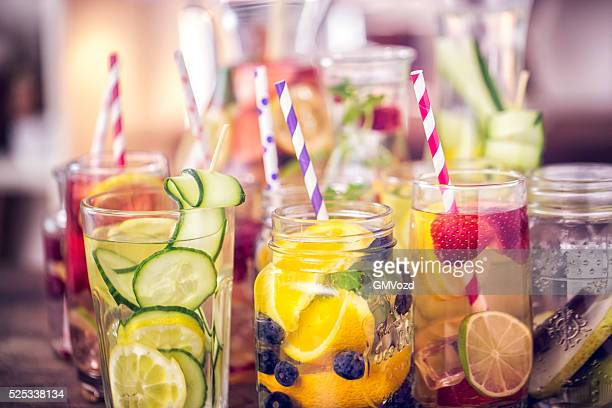 variation of infused water with fresh fruits - freshness stock pictures, royalty-free photos & images