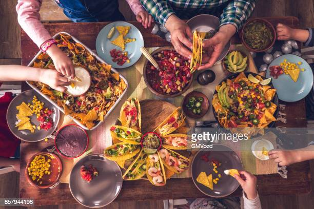 variation of mexican tacos with spicy salsa and nacho tortilla chips - mexico stock photos and pictures