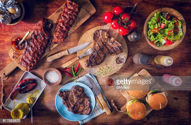 variation of roasted bbq rib eye,  t-bone steak, spareribs and burgers - sparerib stock photos and pictures