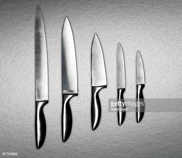 A variation of silver knives in a row