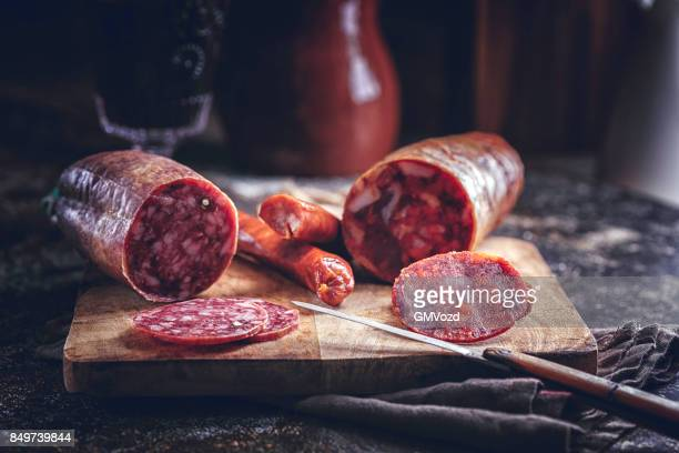 variation of spanish appetizer salami, sausage, ham and good quality cheese - iberian stock photos and pictures