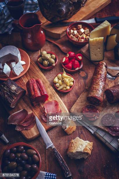 variation of spanish salami, sausage, ham and good quality cheese - serrano ham stock photos and pictures
