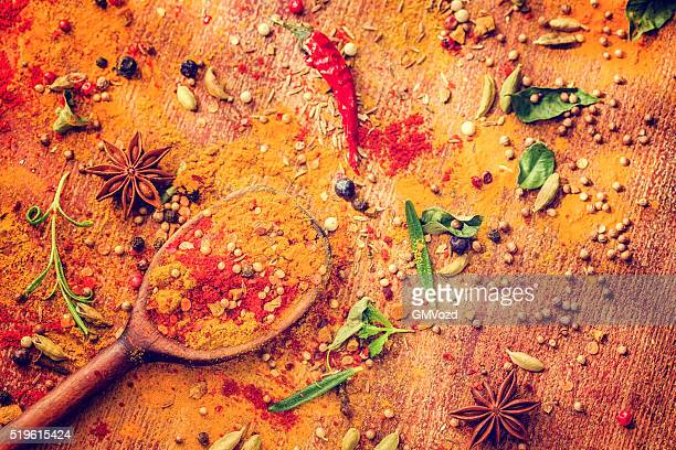 Variation of Spices and Herbs on Wooden Background