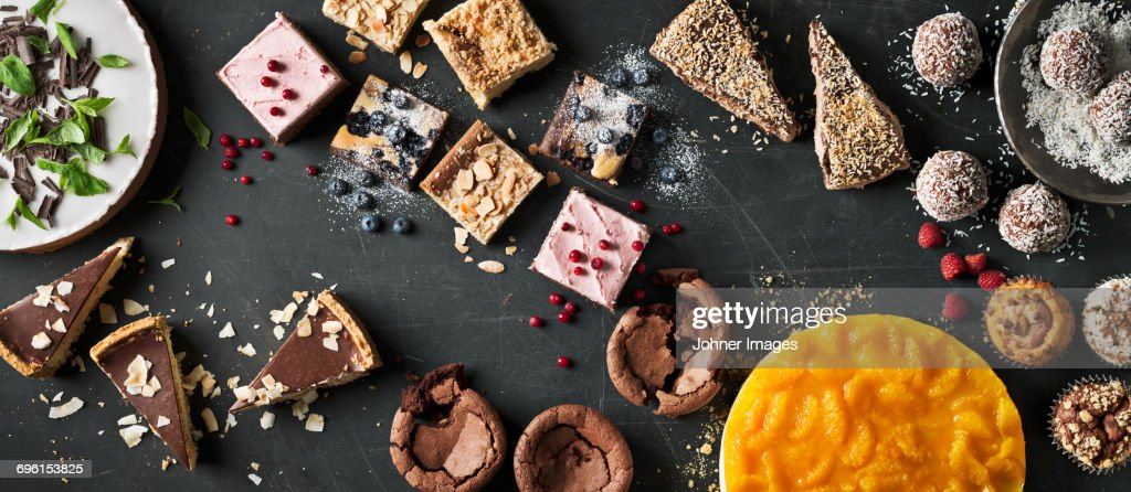 Variation of sweet cakes on table : Stock Photo