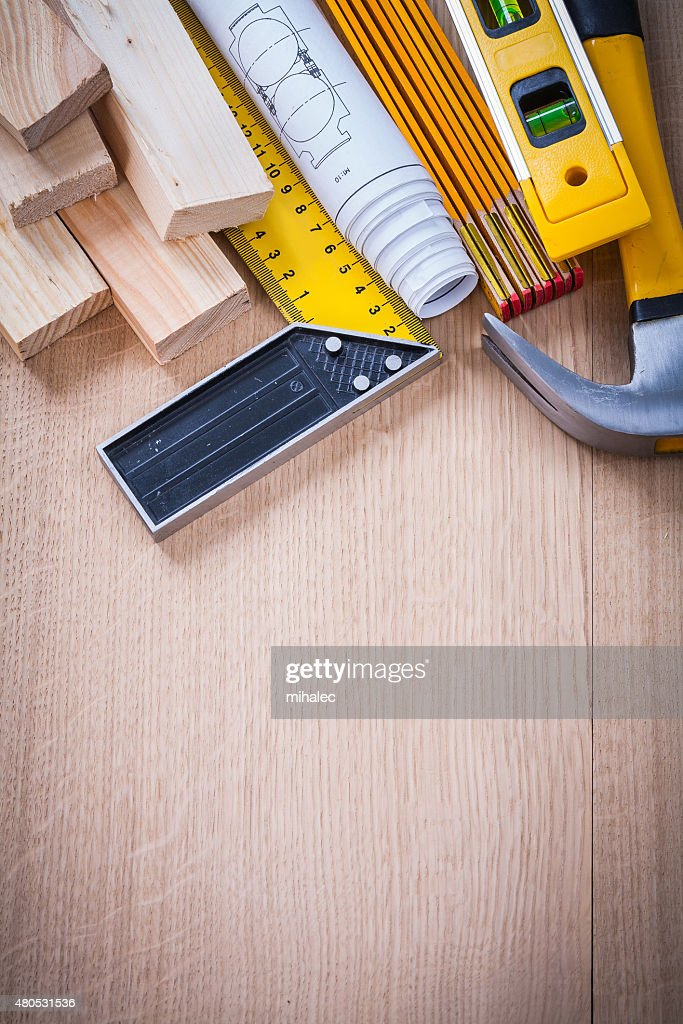 Variation of working building tools on wooden board vertical ver : Stock Photo