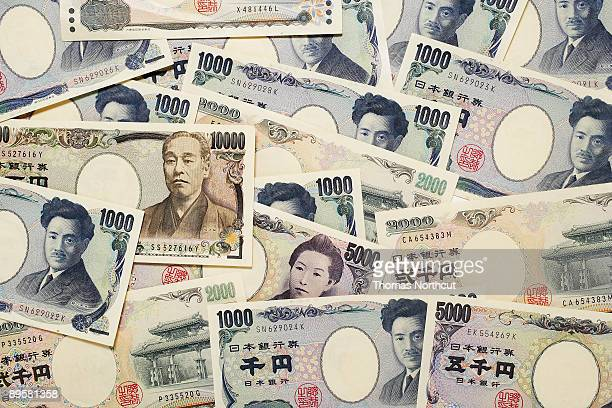 variations of japanese yen currency - japanese yen note stock photos and pictures