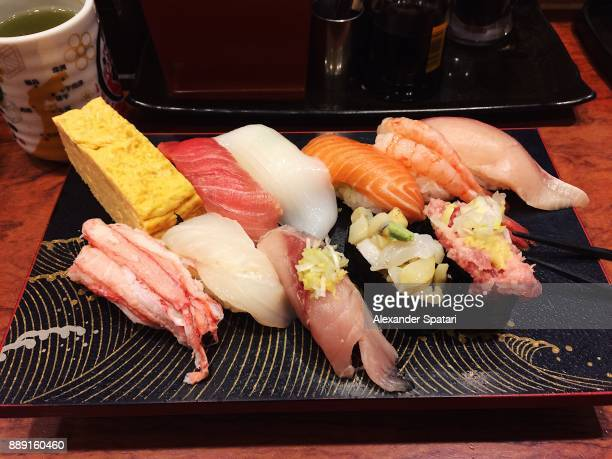 variaty of sushi nigiri on board, high angle view - sushi restaurant stock photos and pictures