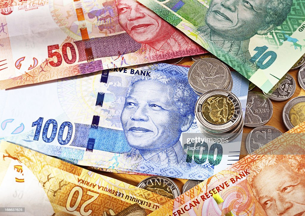 Varied new South African Mandela banknotes with coins : Stock Photo