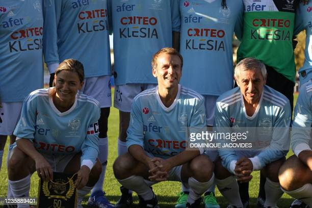 Varietes club de France players including French President Emmanuel Macron pose for a photograph prior to a football match against AS Poissy's as...