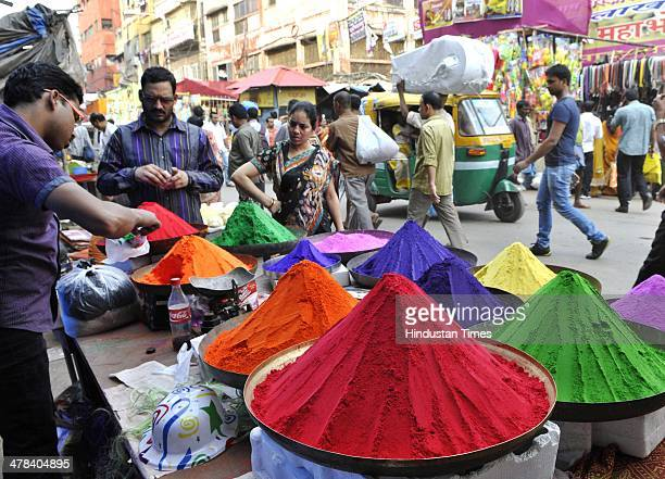 Varieties caps and water canons to celebrate Holi festival for sale at Burrabazar Satyanarayan Park on March 13 2014 in Kolkata India Holi is a...
