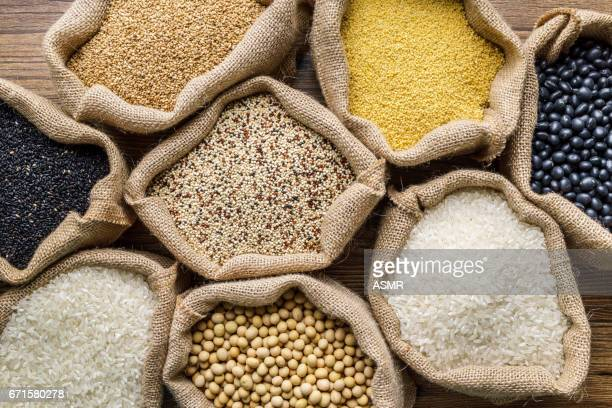 varieties of grains seeds and raw quino - raw food stock pictures, royalty-free photos & images