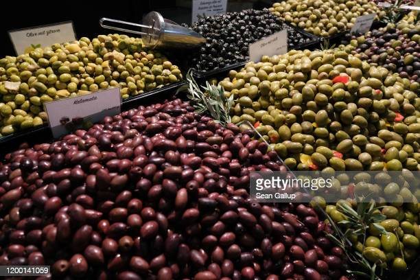 Varieties of olives, including kalamata, lie on display at the Green Week agricultural trade fair on January 17, 2020 in Berlin, Germany. Green Week...